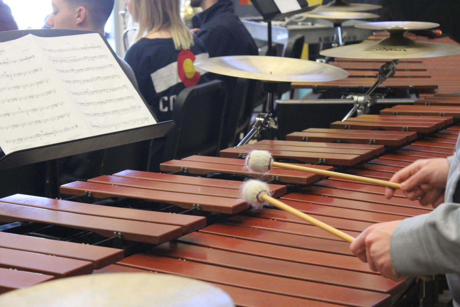 A student in band plays the Marimba.