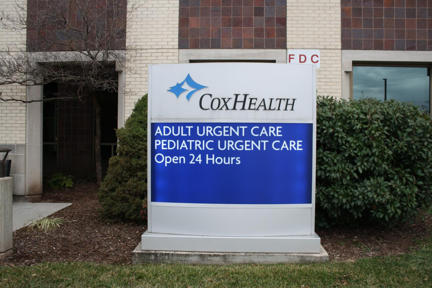 Sign in front of Cox south medical center