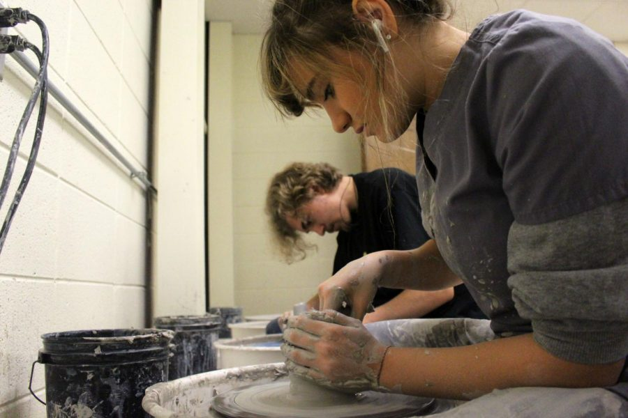 Students form clay pots for their pottery class.    Photo by: Theodore Strickland
