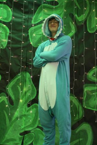 Sophomore Foster Barron wearing his PJ onesie for Fridays theme of The Lion Sleeps Tonight!