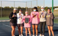 Kickapoo Girls' Tennis hold the Ozark Conference Championship plaque.