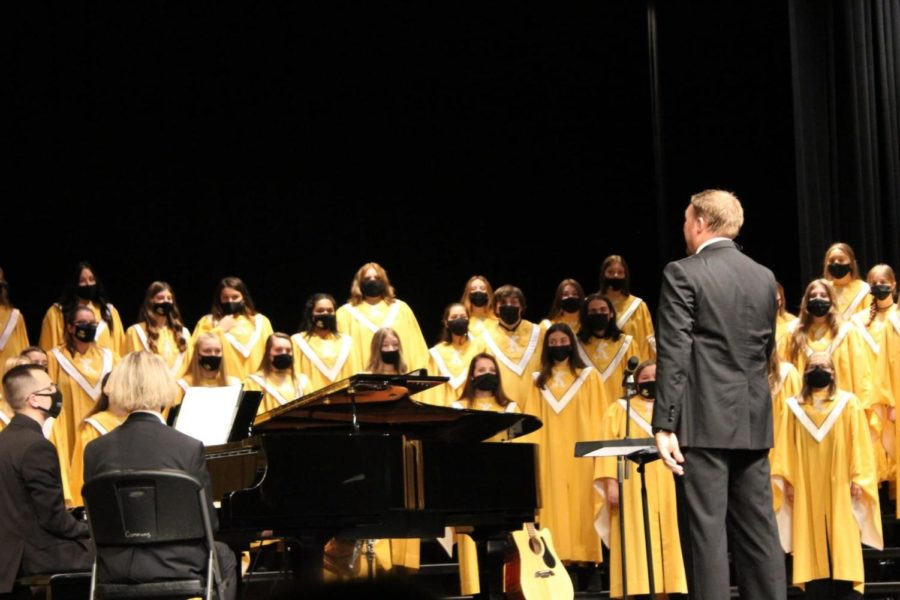 Mr. Cornelius leading the Concert Choir in a song.