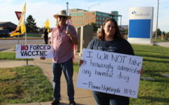 Unnamed protesters stand outside the Cox hospitals protesting the vaccine mandate for employees.