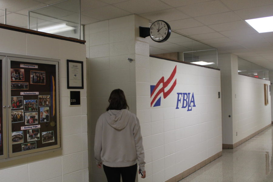 A student goes to room 235, interested in learning more about joining FBLA.