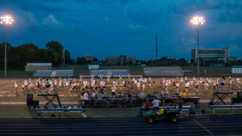 The Kickapoo Golden Arrow Band prepares for an upcoming competition on the football field.